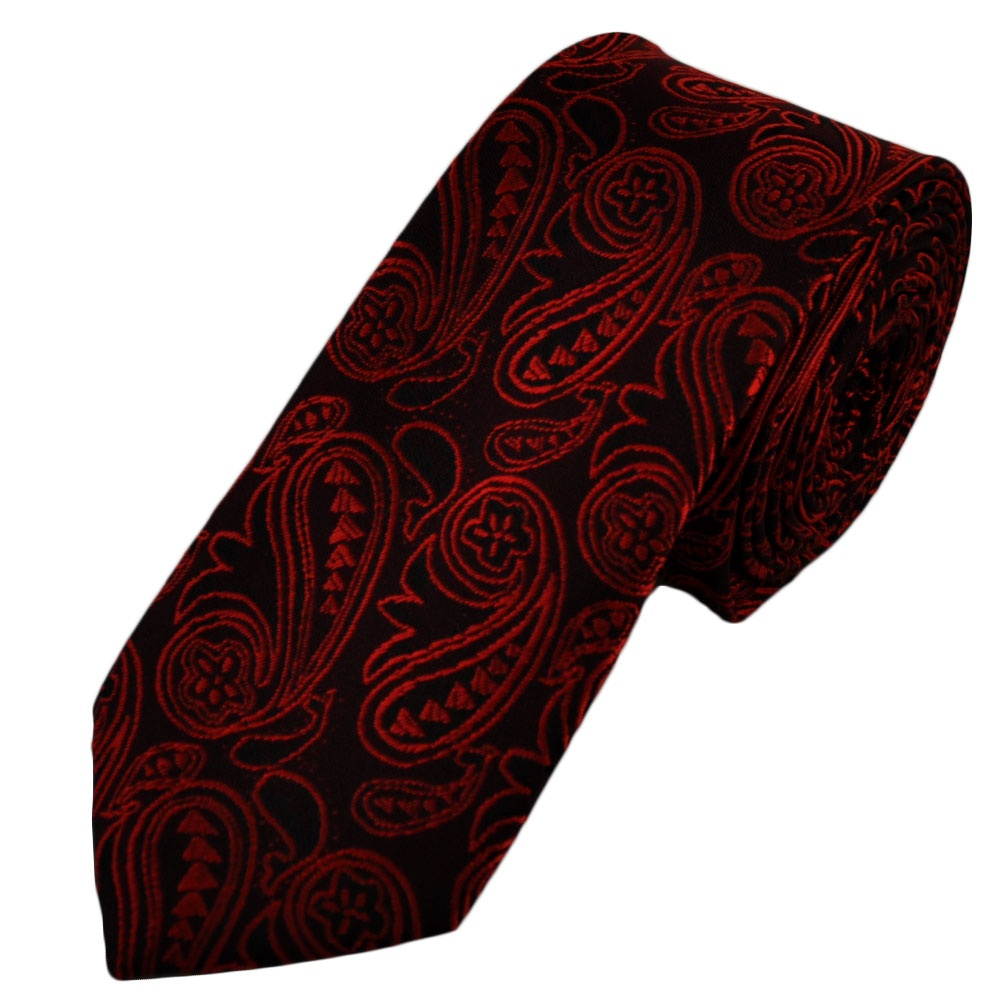 Want a tie that is out of the ordinary, stylish, trendy, but still well suited for any office environment. Then this is the right choice tie for you! A classic floral design and intricate paisley pattern is combined with a trendy burgundy-red and black color combination.
